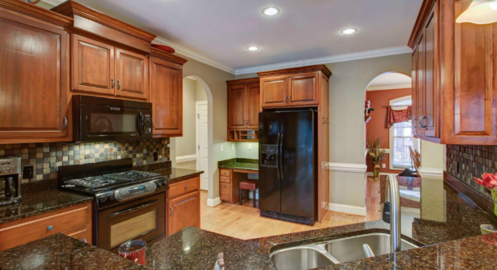 Granite countertops and a beautiful backsplash create a gorgeous kitchen.