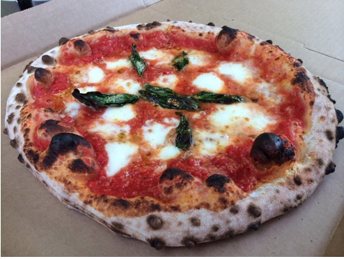 Capps' crust is light and crisp on the outside and soft and tender on the inside with the cornice that is puffy and full of bubbles providing a perfectly balanced crumb only found in Neapolitan pizza. It doesn't get better than this, folks!